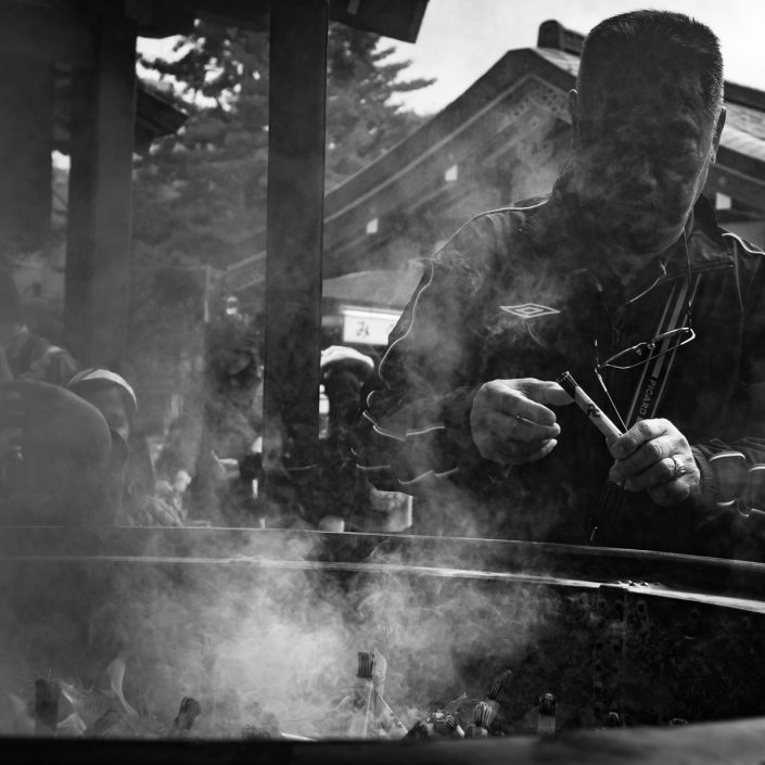 Man lighting incense
